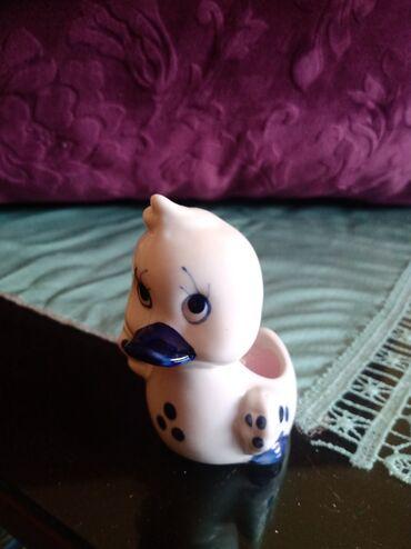 Figurine | Srbija: Porcelanski nov svecnjak. visina. 8cm. precnik. 6cm