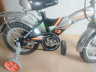велосипед с детской коляской в Кыргызстан: Детский велосипед состояние почти новое отдам за 2000