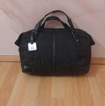 Tašne - Pozarevac: Original Calvin Klein tasna, boja crna.  Dimenzije: 40×27cm