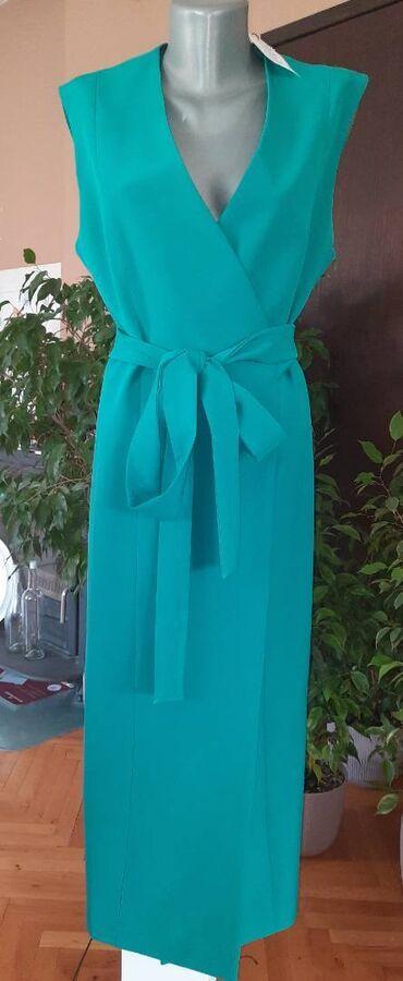 Nova prsluk haljina na preklop. Jako kvalitetnog i cvrstog materijala