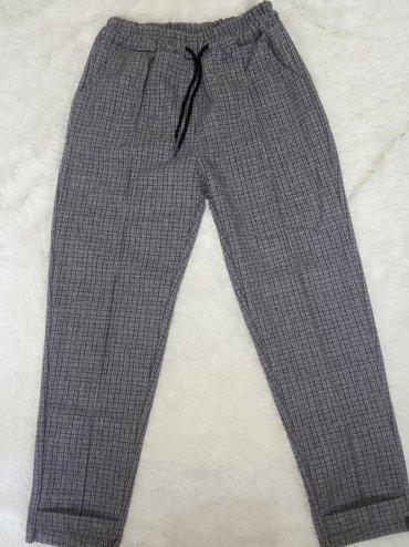 Женские брюки довольно плотный материал больше подойдёт на