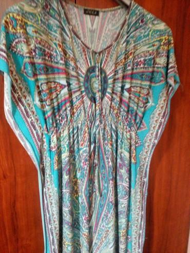 Duga haljina u tirkiznoj boji sa leptir rukavima i lastisom ispod - Novi Pazar