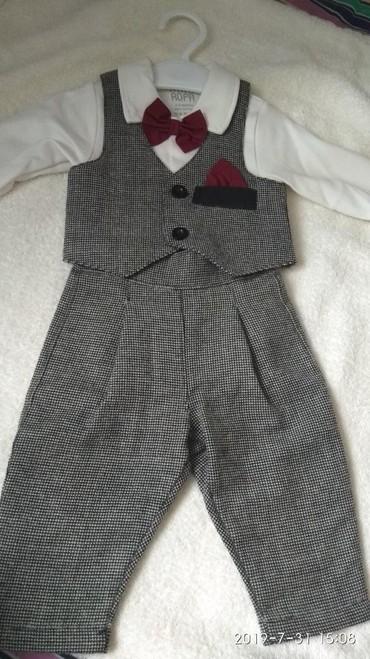 Продаю элегантный, стильный костюмчик для маленьких джентльменов. возр