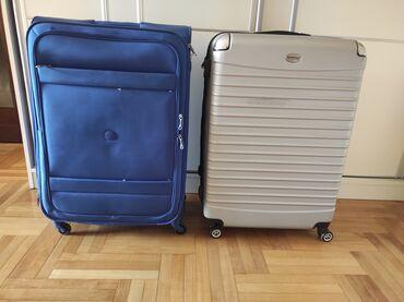 Dva kofera, velika. Dimenzije 79x31x52. Oba su jako kvalitetna, skroz