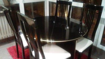 Prodajem trpezarijski sto i 4 stolice simpo, crni visoki sjaj, prečnik - Beograd