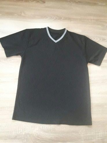 Crna muška majica,veličina XL..Nekoliko puta nošena stanje odlično - Novi Pazar