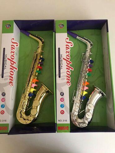Saksofon muzička igračka za decu CENA: 2100 din CENA JE PO KOMADUKod