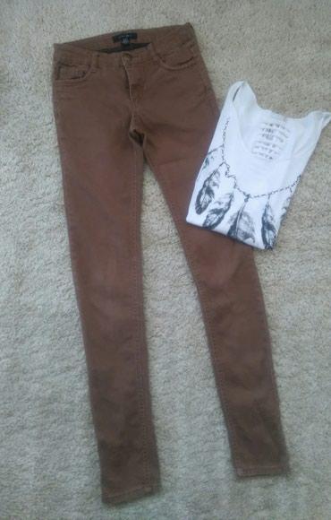 Helanke-elastina - Srbija: Uske braon pantalone skroz kao helanke. Ima elastina. Klasicni dzepovi