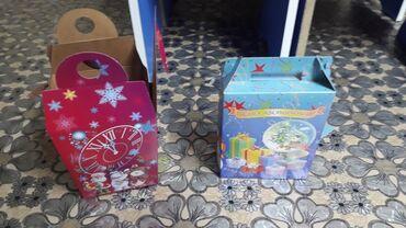 Продаю коробки новогодние 12 сом за один штук есть 150штук