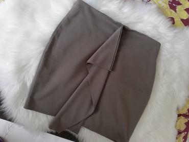 NOVA suknja, elastična, odgovara M i L jer je elastična. Za više - Kragujevac
