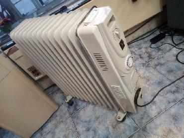 Radijatori - Srbija: Uljni radijator Vox Elektronik sa 13 rebara. Ispravan na tockice. Ima