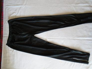 Crne helankice za sve prilike, sa zipovima na nogavicama koji se - Belgrade