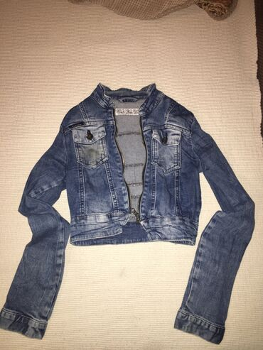 Kratka teksas jaknica, vrlo malo nosena. Ocuvana kso nova