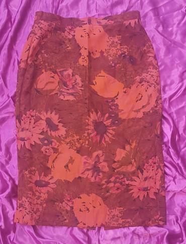 Pozadi-slic-dug-cm - Srbija: Narandžasta suknja, vel. 40. Suknja je postavljena i ima slic pozadi