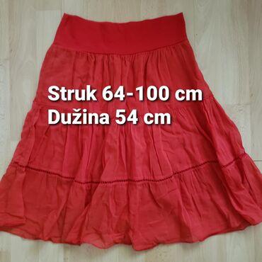 Suknja na gumu sa karnerima i postavom. Očuvana, kao nova.Širina