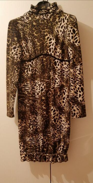 Topla extra Animal print haljina.Fantssticna,skoro sasvim uz