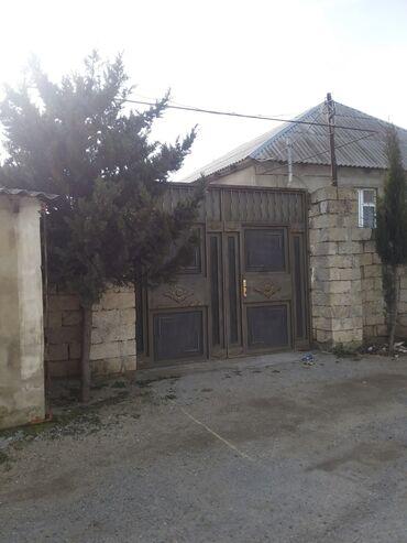 Ev və bağ - Novxanı: Bu gördynüz həyət ev satilir. ayri boş torpağda var obşidə satilir