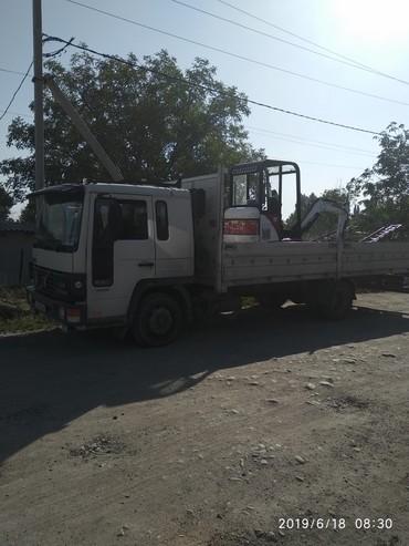 Другие услуги - Лебединовка: Услуги мини трактора фронтальный погрузчик,погрузка планировка,впашка