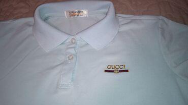 ворота джалал абад в Кыргызстан: Продаётся голубая футболка с воротником и логотипом Gucci. В хорошем