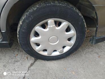 железные диски на 15 в Кыргызстан: Продаю железные диски вместе с зимними шинами есть колпаки. 195/65/15