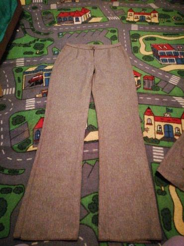 Njih-su-di - Srbija: Pantalone a preko njih ide suknja na preklop vel38