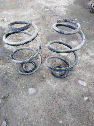 Продаю задние пружины на ниссан марч 2003 год к 12 оригинал