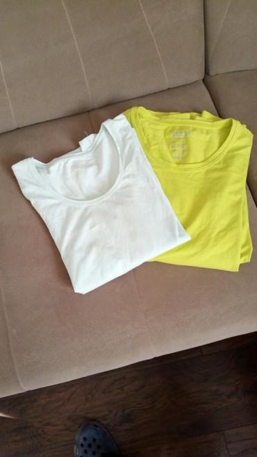 Ženska odeća   Kucevo: Majice sa elastinom kao nove br 44 .uvoz.nosene jednom,obe za jednu