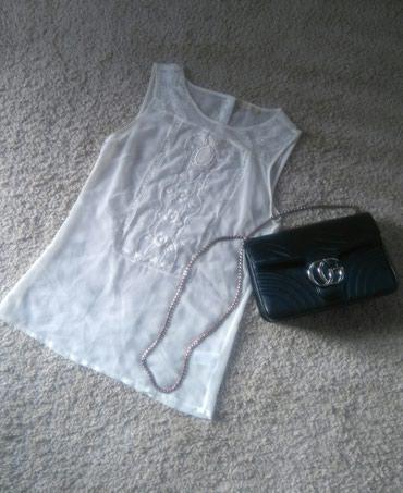 Pantalone elegantne - Srbija: Elegantna bluza sa radomPrljavo bele za nijansu krem boje. Svecana