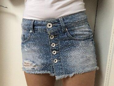 Zimska mini karirana suknja poluobim struka je - Srbija: 2 mini suknje+ 2 šortsa + 1 gratis.  Modeli nisu dobukog struka. Zara