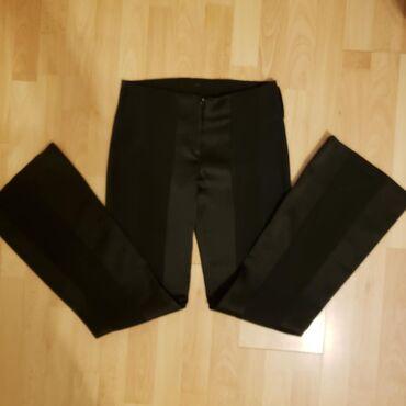 Duzina obim cm - Srbija: Prelepe elegantne pantalone. Blago zvonaste pri dnu.Obim struka = 75