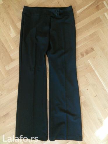 Pantalone-benetton-e - Srbija: Benetton klasične crne pantalone sa ravnim i širim nogavicama, malo