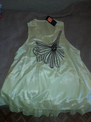 Платьеце, можно как туничку. С подкладом в виде мягкой сеточки. Размер в Бишкек