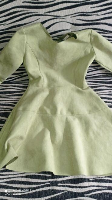 Новое замшевое платья.44 размера.Причина продажи :купила в Россиино