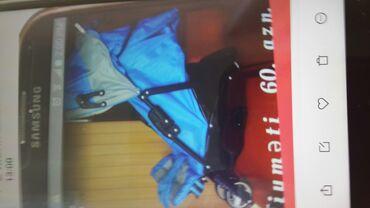 Детская коляска голубого цвета. б/у. в хорошем состоянии