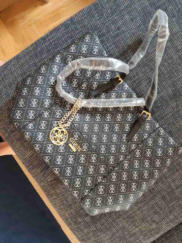 Torba dimenzije - Srbija: ** Guess torba novo AKCIJA **Dimenzije su: - duzina: 29 cm (bez
