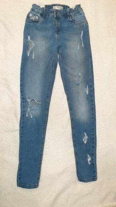Рваные джинсы писк моды. На возраст 9-12лет