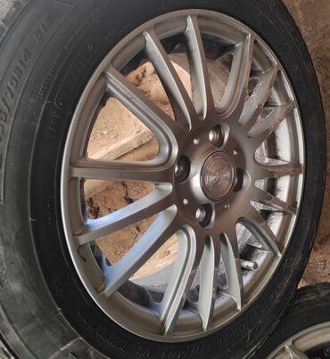 купить диски для машины в Кыргызстан: Новые шины с титановыми дисками. 4шт. Зимние. Купили в декабре. В связ
