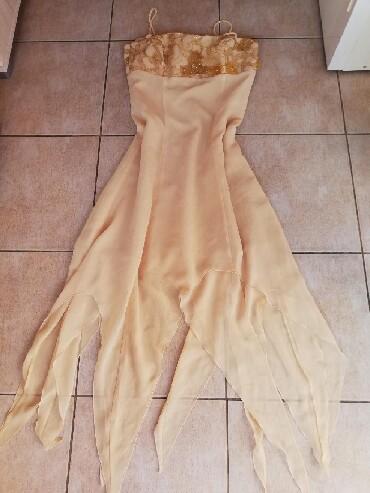 Ženska odeća | Nova Pazova: Nova haljina kupljena u Grčkoj. M veličina. Elegantna. Ojačan gornji d