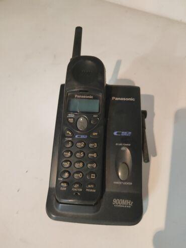 Продаю домашний телефон нужно заменить батарейку и шнур для зарядки