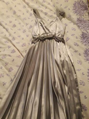 Siva haljinica jednom obicena l vel 500din
