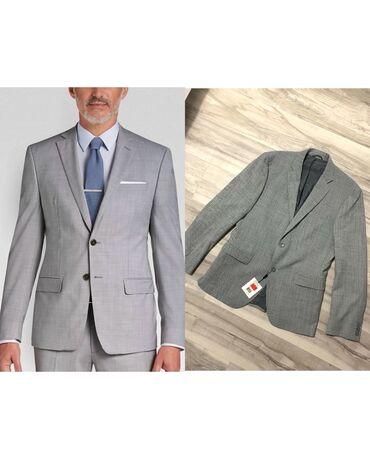 Calvin Klein novo musko odelo, slim fit. Velicina 52. Kupljeno u