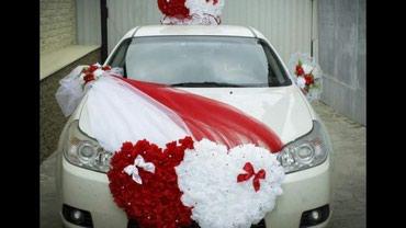 свадебная фотосъемка в Кыргызстан: Свадебные кольца и украшение авто