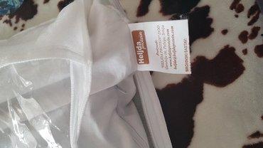 Heljdin jastuk nov,ima i dodatno punjenje u kesi. Tezak 2.5 kg. Placen