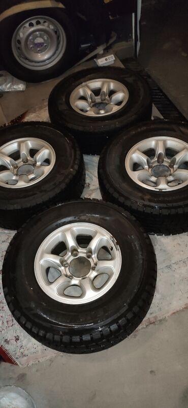 Продаю шины с дисками липучка (зима) DUNLOP GRANTREK 265/70/15 в очень