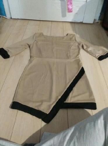 Haljine | Kikinda: Haljina, asimetricna napred. Krem boje, nošena jednom. Porucena