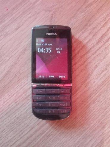 Nokia | Lazarevac: NOKIA ASHA 300. kao nov,radni vek baterije pet dana,polu touch,sva