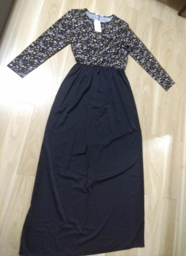 Продаю новое женское длинное платье размер 46-48 написано xl ткань