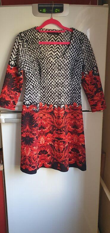 Итальянское пдатье Размер М  Состояние нового платья