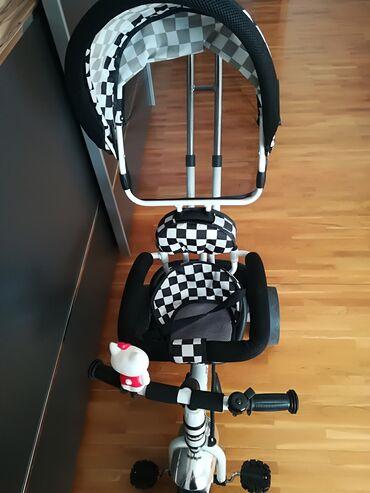 Decija kolica - Srbija: Prodajem decija bicikl kolica. Kolica su koriscena svega par puta. Za