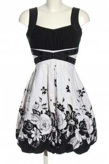 Elegantna crno bela haljina. NOVO. U besprekorno stanju. Nema tragova